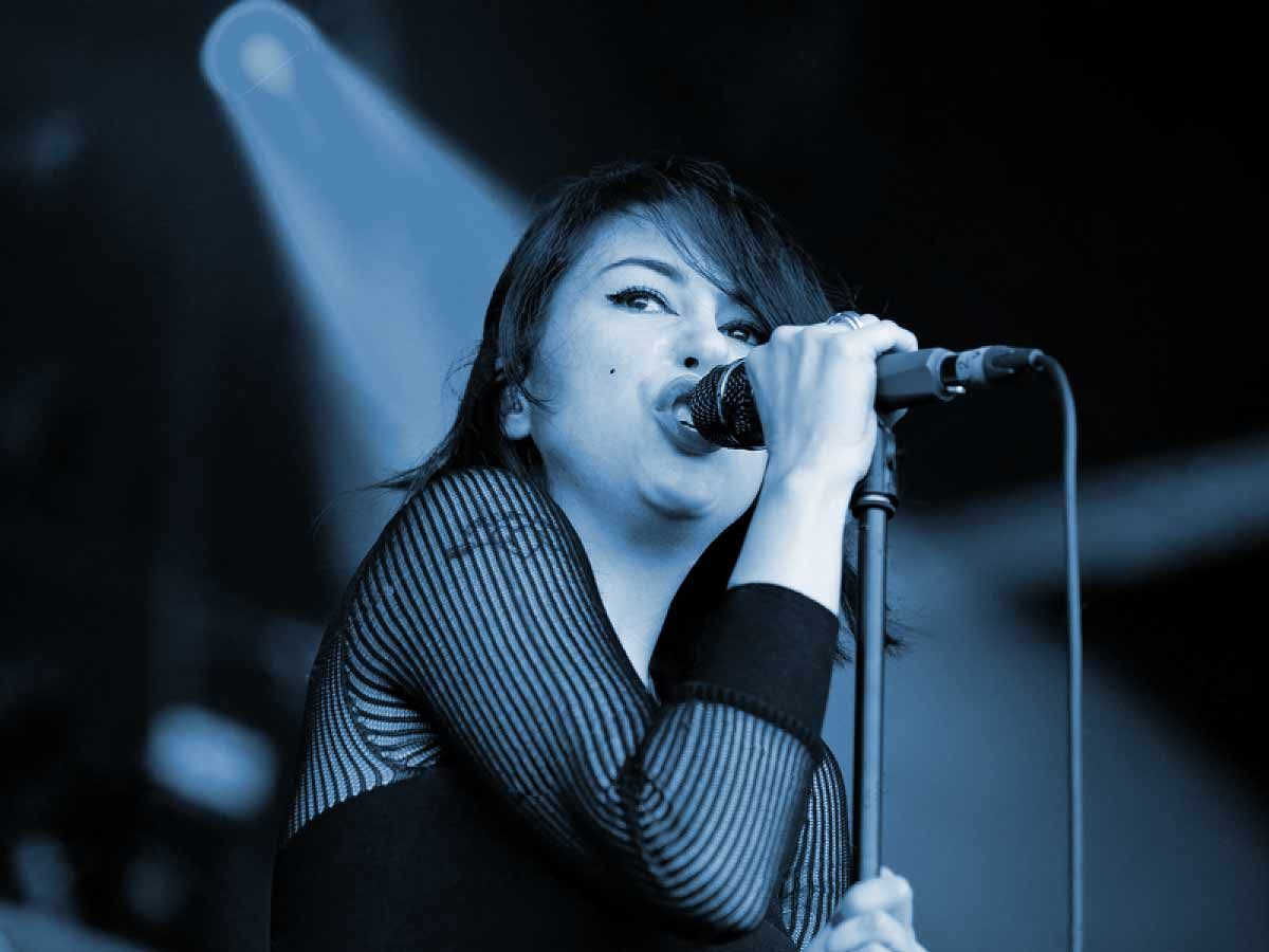 Singing Lessons London Advanced - Young Female Singer performing with a microphone