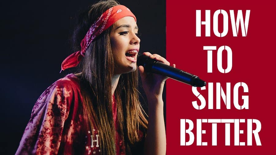 Beautiful Female Singer With A Bandana Learning How To Sing Better With A Microphone